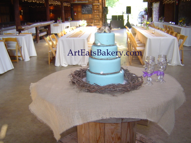 Robin's egg blue modern custom wedding cake design with grapevine wreaths, nest and birds topper at the Dutch Barn in Greer, SC.jpg