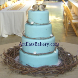 Robin's egg blue modern custom wedding cake design with grapevine wreaths, nest and birds topper.jpg