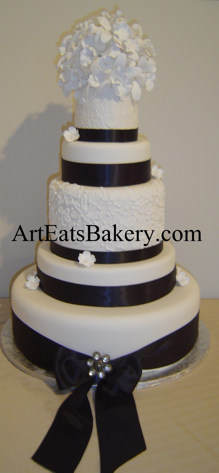5 tier custom unique elegant Black and white wedding cake design with sugar orchid flower topper, ribbons, bow and brush embroidery.jpg