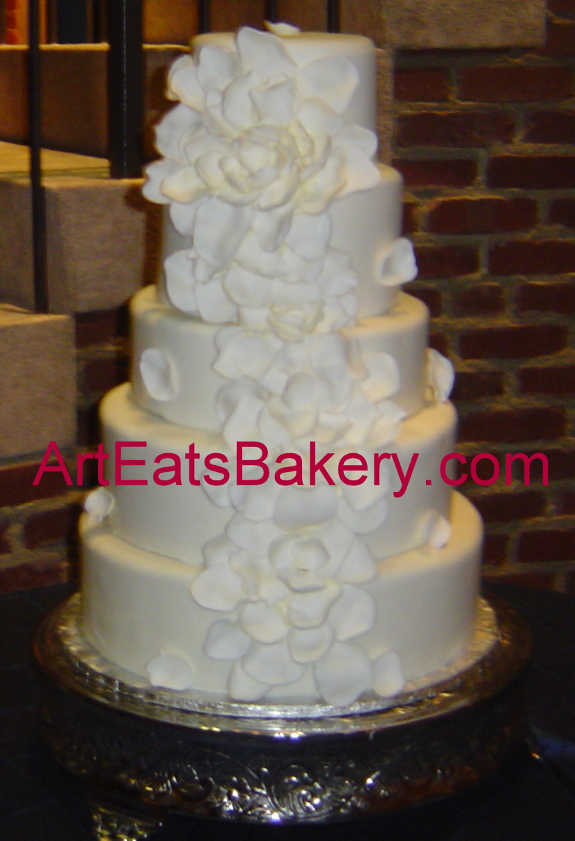 Five tier fondant elegant wedding cake with a dramatic unique white sugar flower design 2.jpg