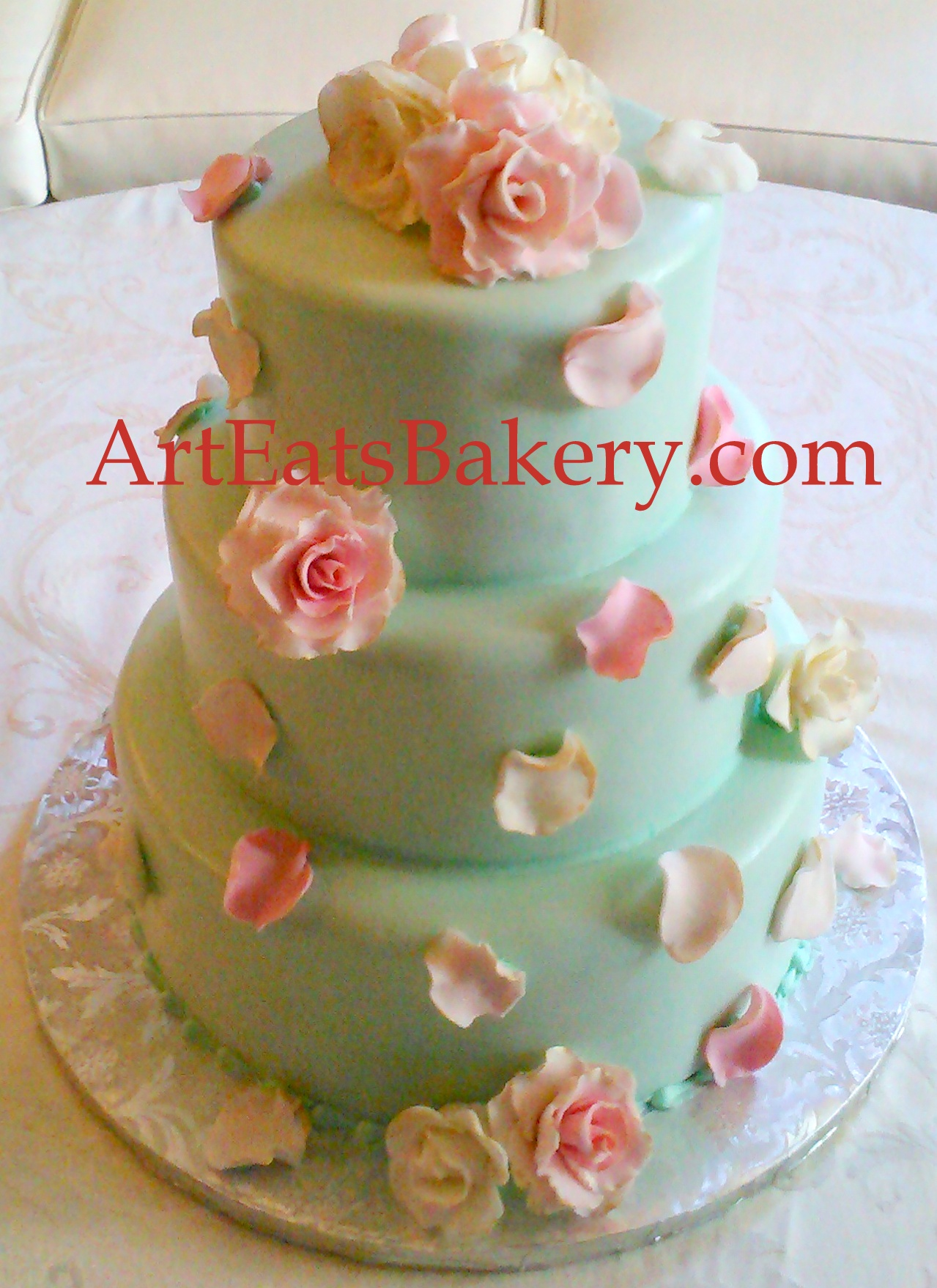 Three tier mint green fondant elegant romantic wedding cake with edible pink and ivory roses and petals with a touch of gold.jpg