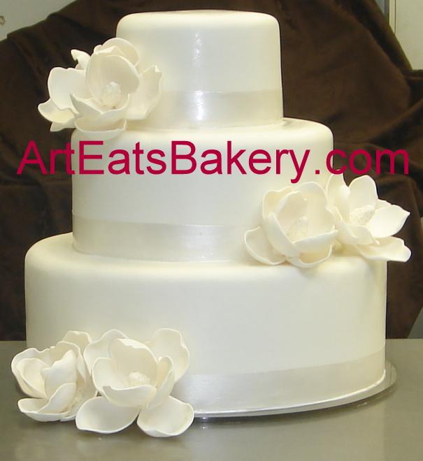Three tier white fondant custom sugar magnolias wedding cake.JPG