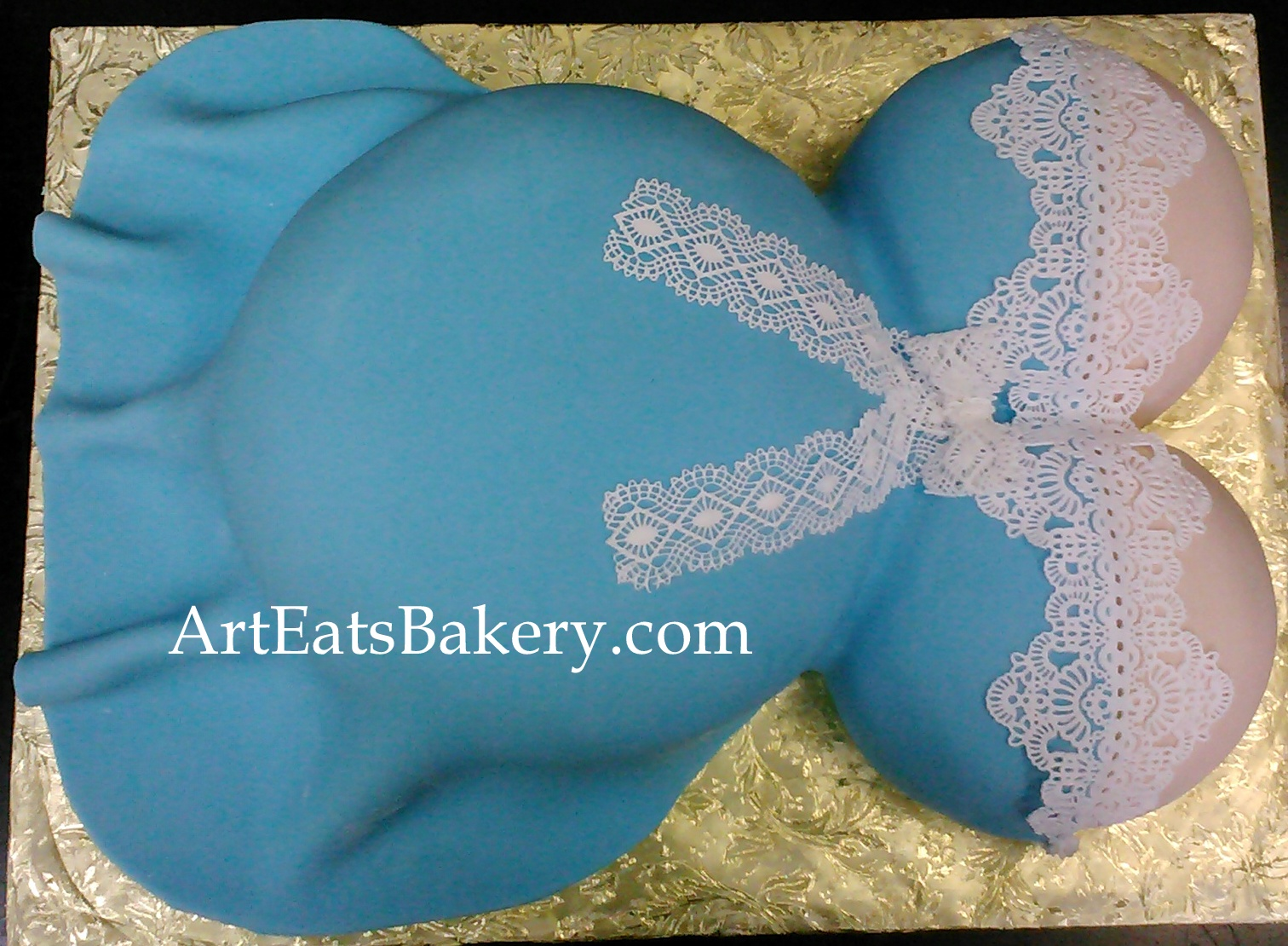 Blue and white boy baby bump shower cake with edible lace and bow design.jpg