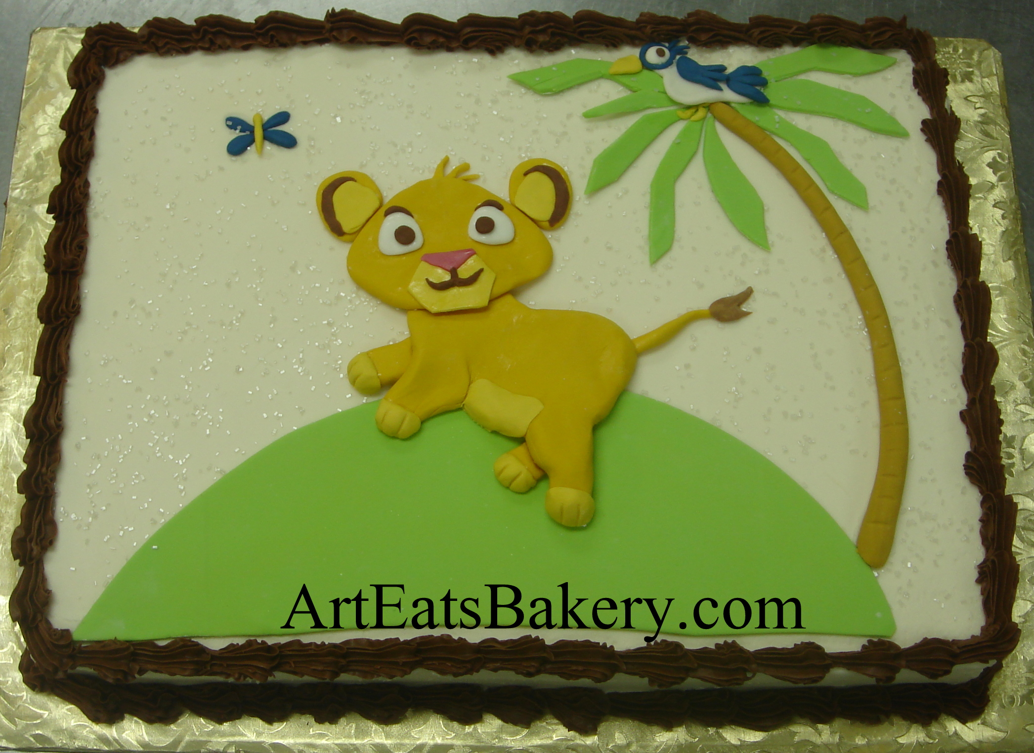 Little Lion King custom baby shower cake desgn with palm tree, bird and butterfly.jpg