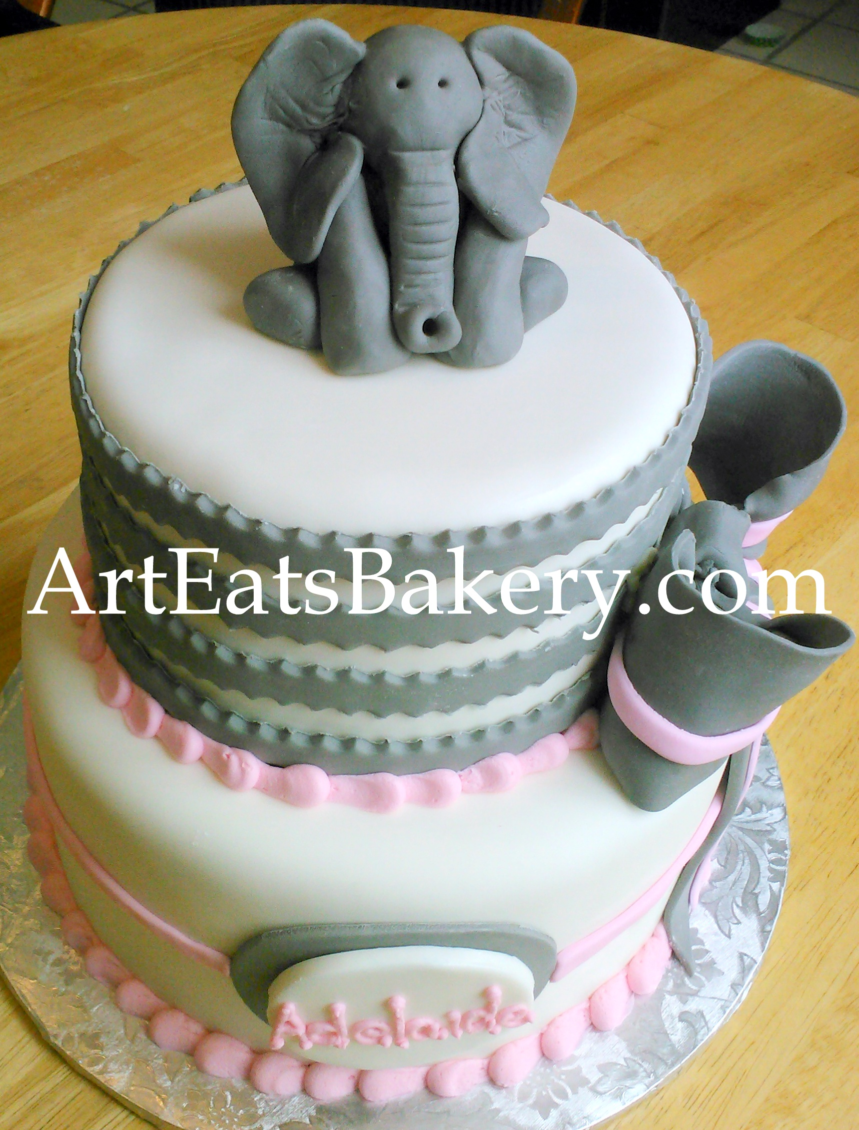 Pink and gray girl's baby shower cake design with bow and edible 3D elephant topper.jpg