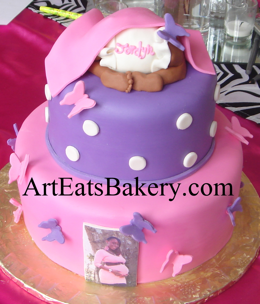 Pink and purple fondant butterflies custom creative baby shower cake with baby under blanket topper.jpg