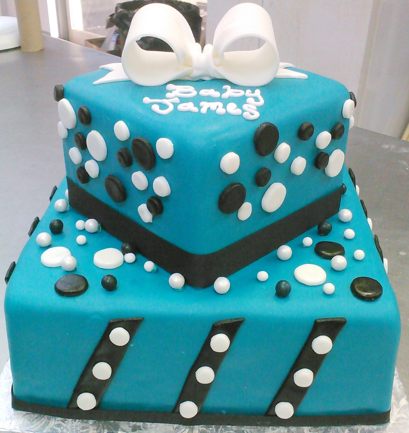 Teal Blue custom square boy's baby shower cake design with black and white stripes and polka dots and edible bow topper.jpg