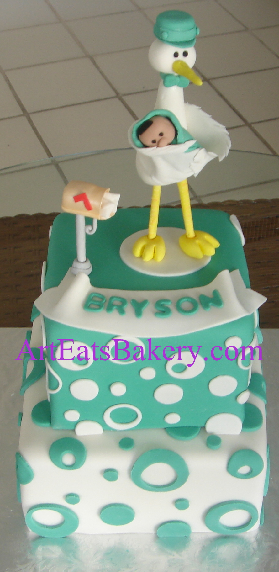 Teal blue dots and circles square two tier fondant modern babyshower cake design with edible stork, baby and mail box topper.jpg