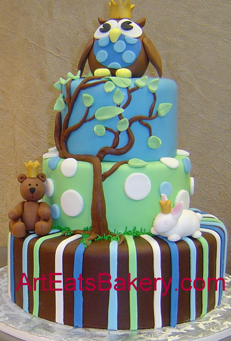 Three tier blue, green and brown stripes and polka dots baby shower cake with tree, owl, teddy bear and bunny.jpg