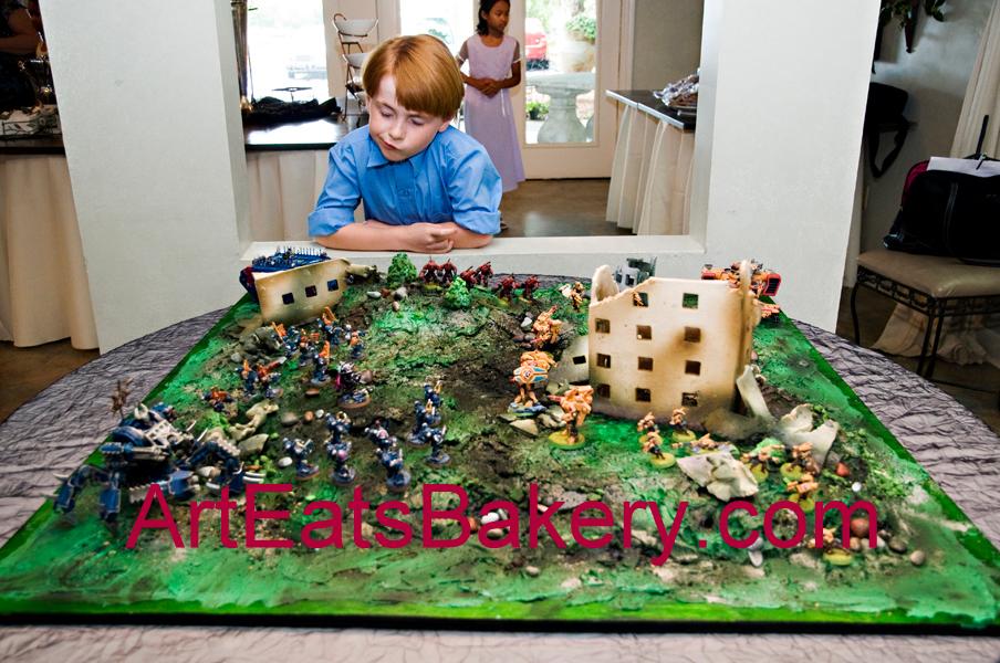 3 foot battle scene Groom's cake with sugar paste demolished buildings and landscape.jpg