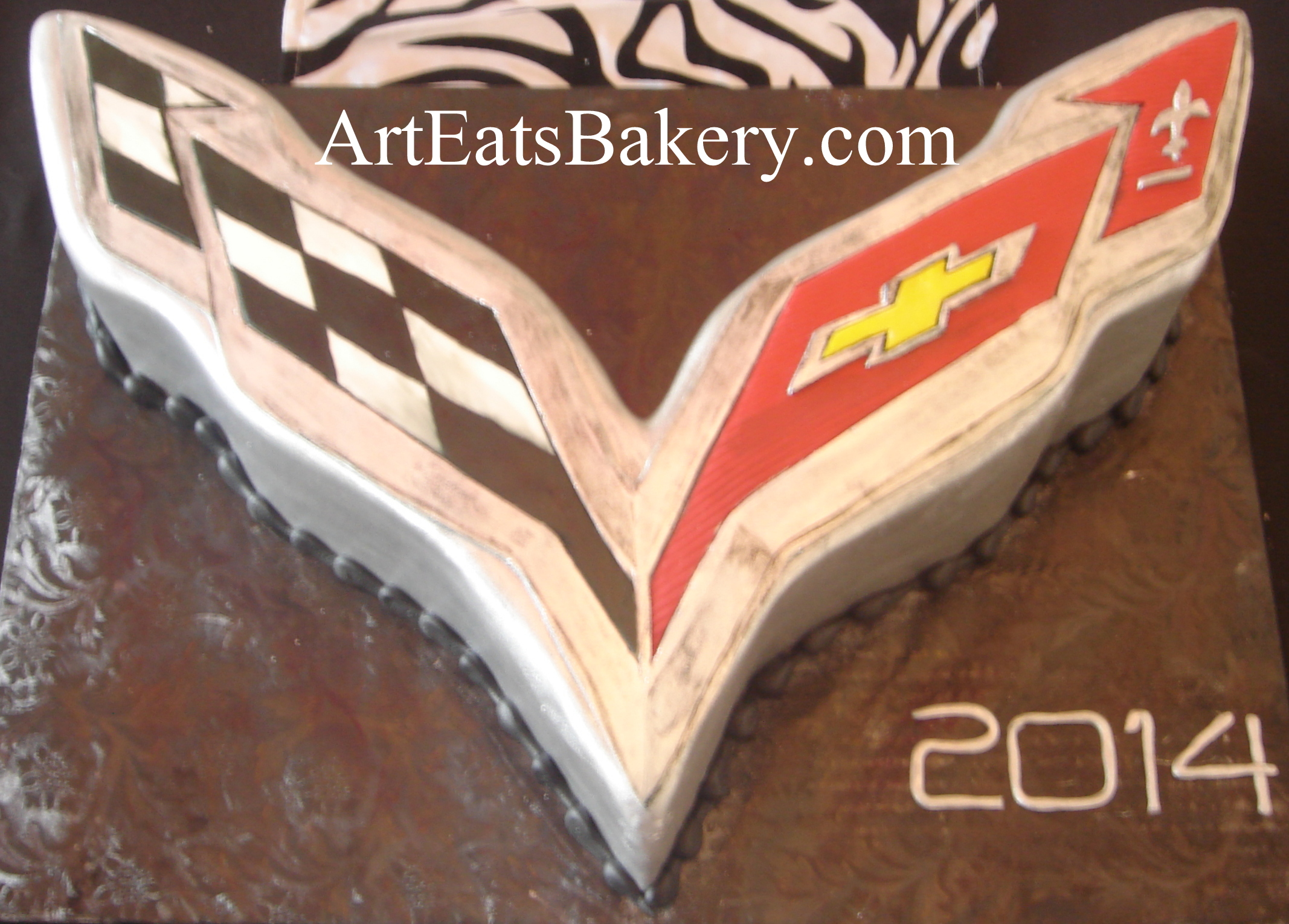 Custom unique silver, black, red and yellow 3D Corvette emblem cake design.jpg