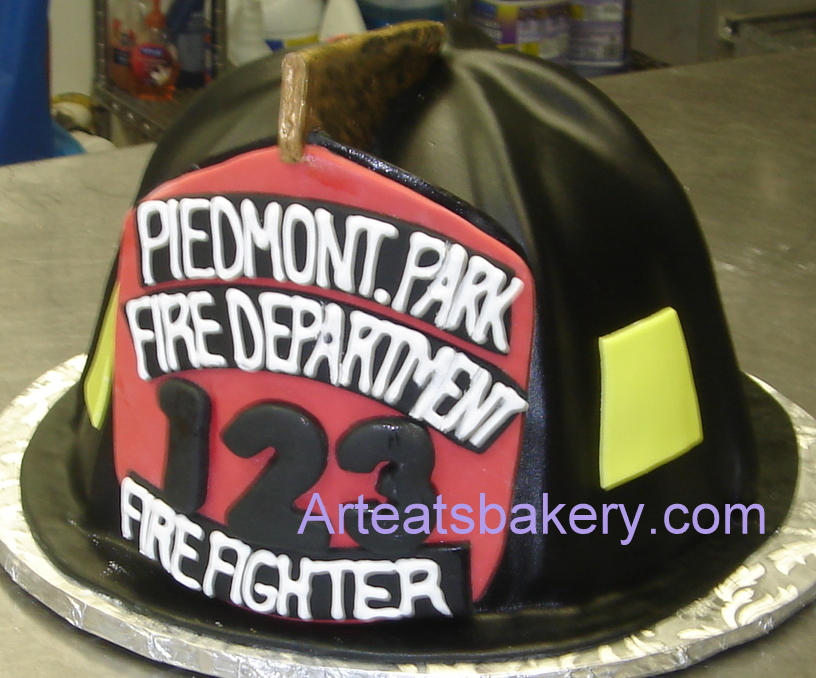 Custom unique sculpted black fondant firefighter's helmet with sugar eagle holding the front plaque.jpg