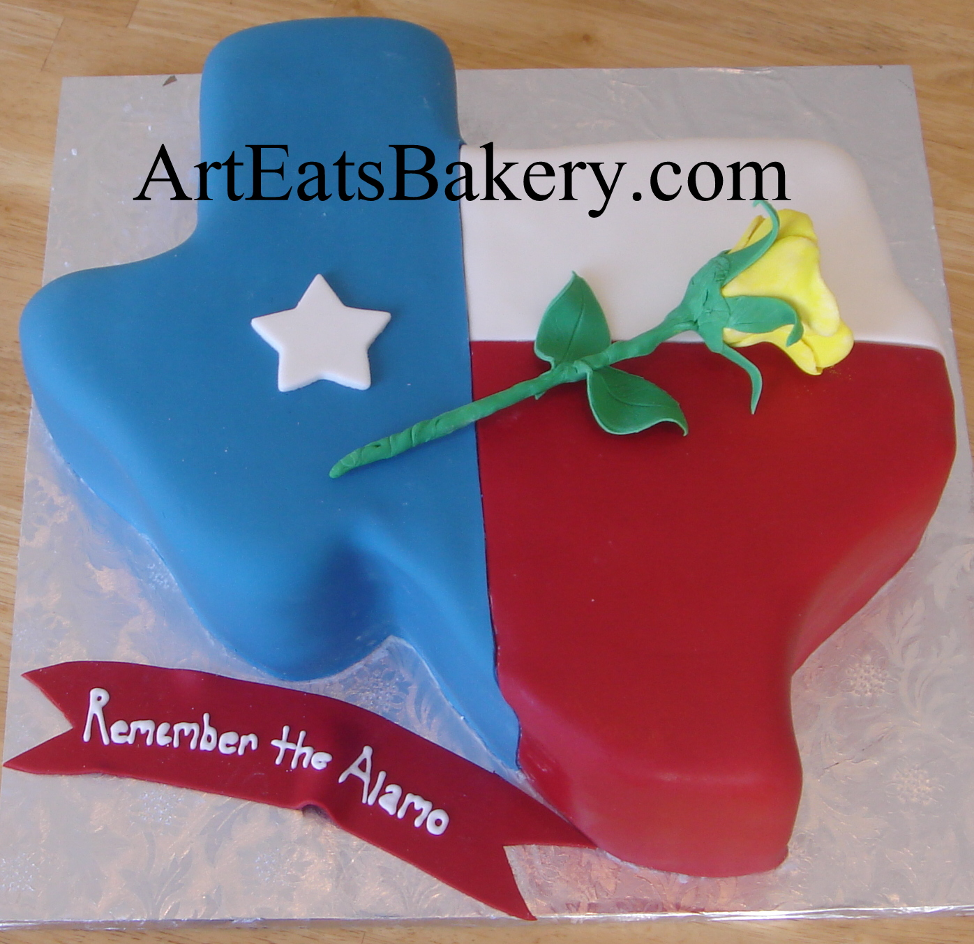 Red white and blue Texas state cut out cake with yellow edible rose and Remember the Alamo.jpg