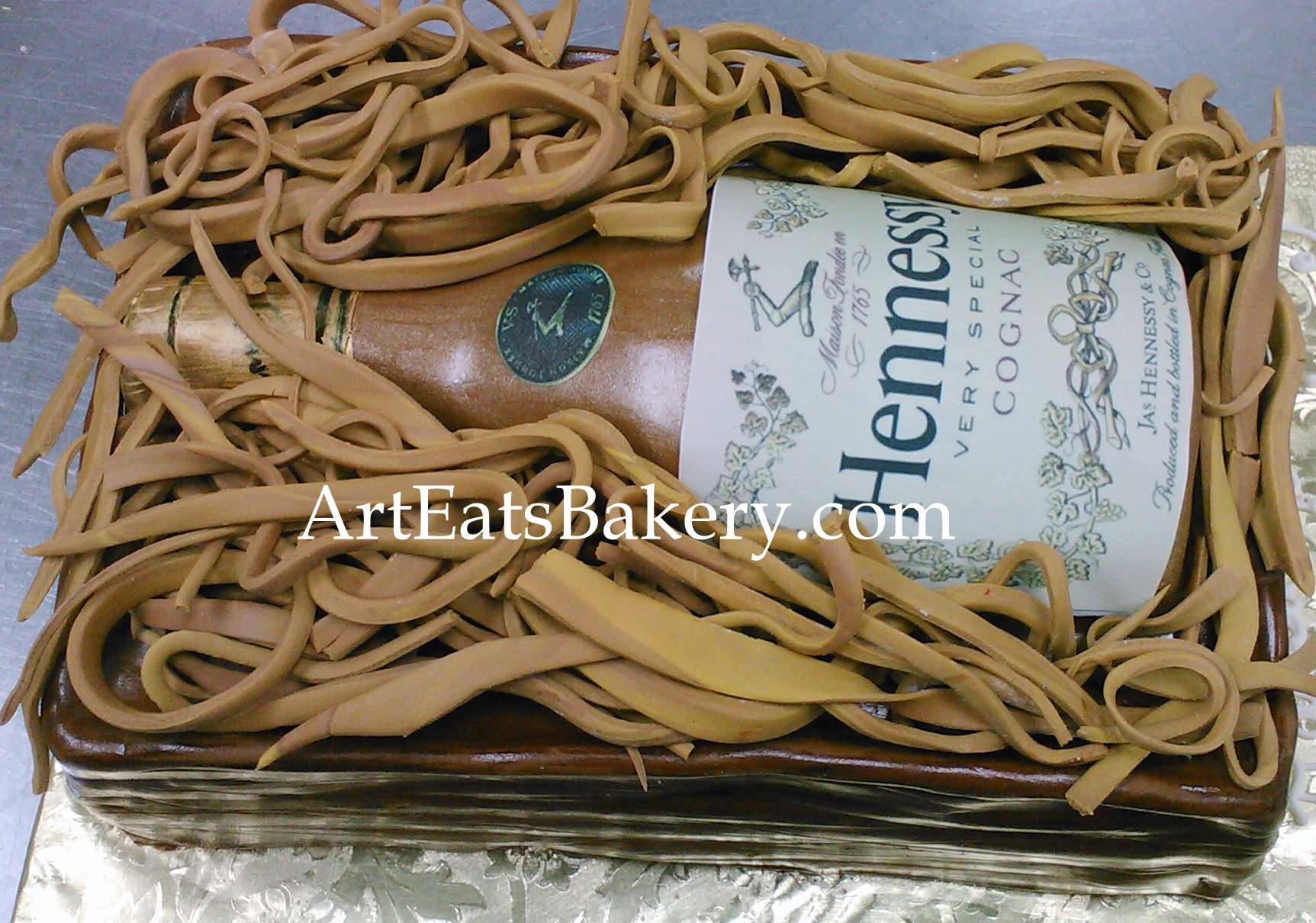 Hennessy bottle in wooden crate with edible straw custom birthday cake design.jpg