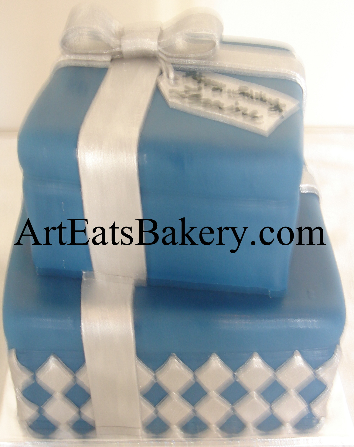 Two tier square blue and silver fondant presents creative custom birthday cake design with diamonds, bow and edible name tag.jpg