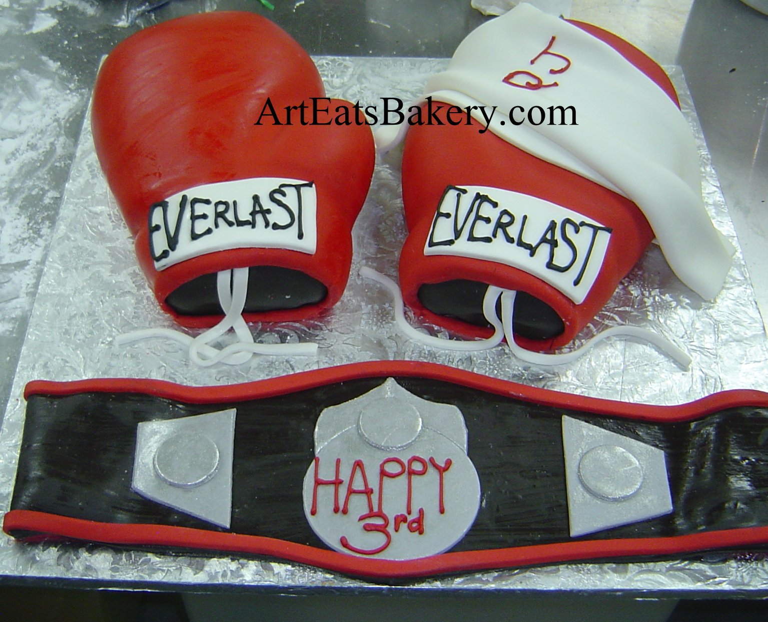 3D red fondant boxing gloves and championship belt unique creative mens birthday cake.jpg