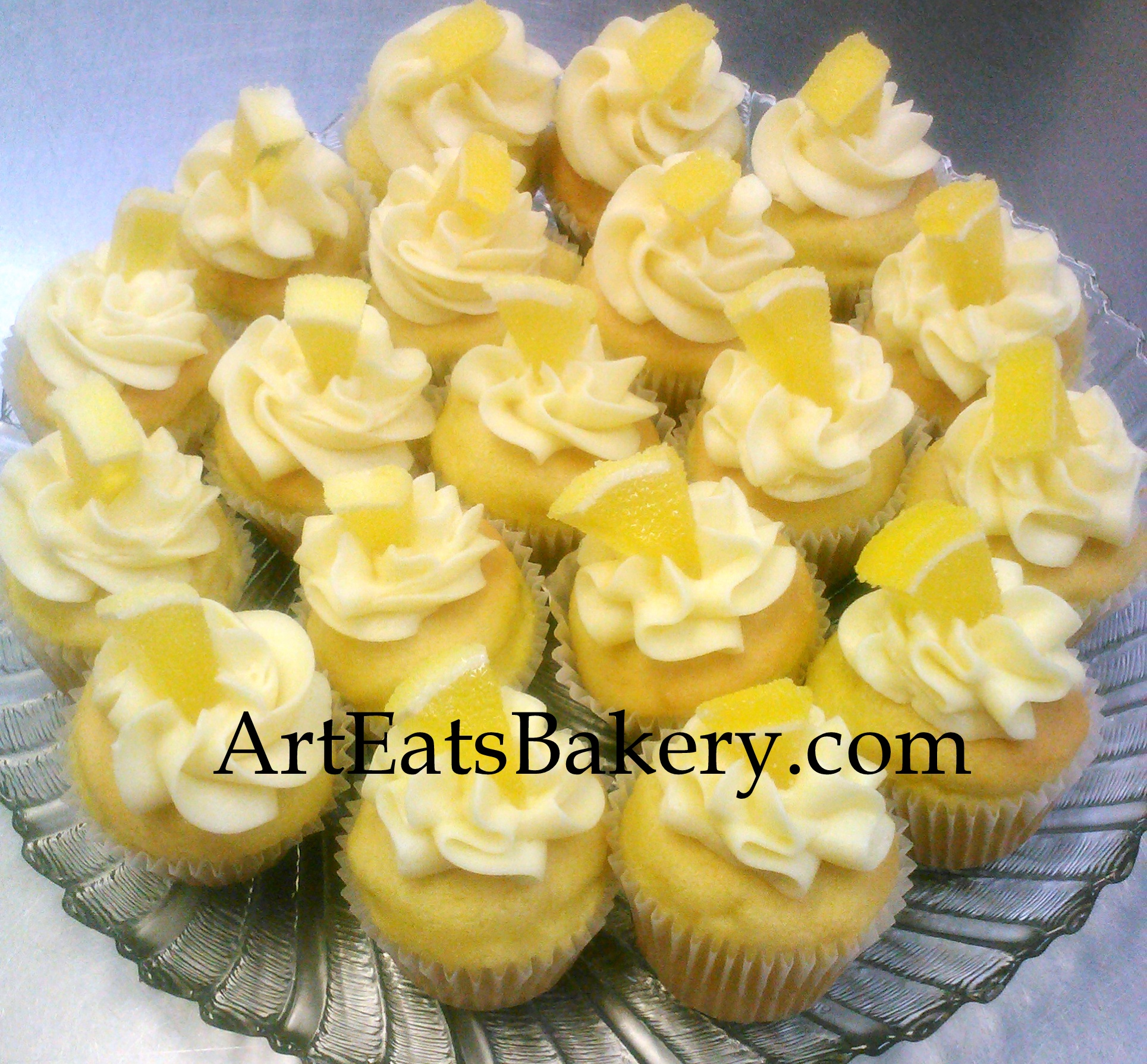 Lucious tart lemon cupcakes with lemon butter cream.jpg