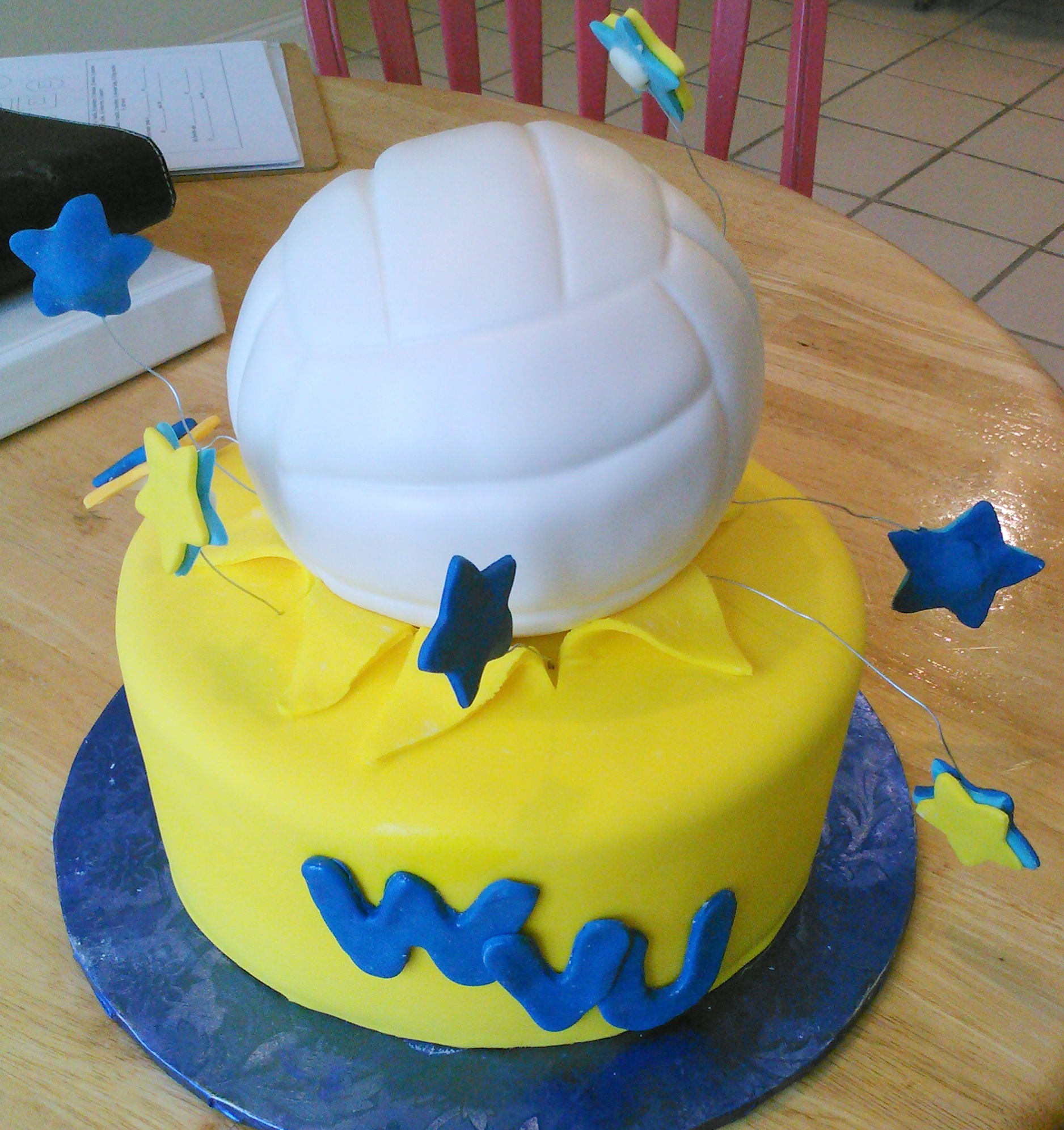 West Virginia University custom birthday cake with volleyball tier and stars.jpg