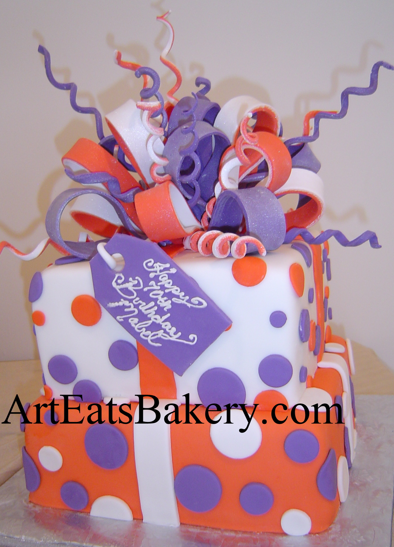 Two tier square Clemson orange, purple and white present design 70th birthday cake with large sugar bow.jpg