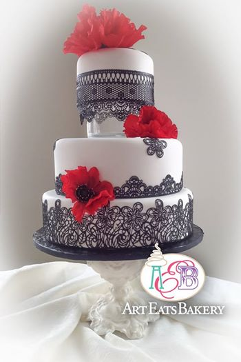 Black edible romantic edible black lace modern wedding cake with bold red poppy flowers.jpg