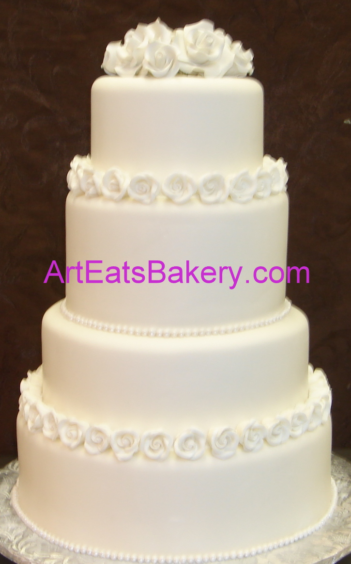 Four tier round classic wedding cake design with white sugar roses and pearls.jpg