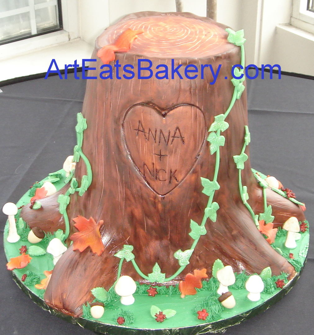 Fondant tree stump custom wedding cake design with leaves, mushrooms and ivy.jpg