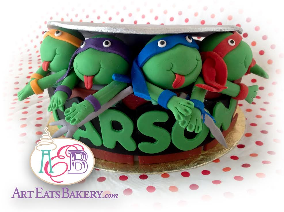 Kid's Teenage mutant ninja turtles birthday cake design with turtles coming out of the sewer.jpg