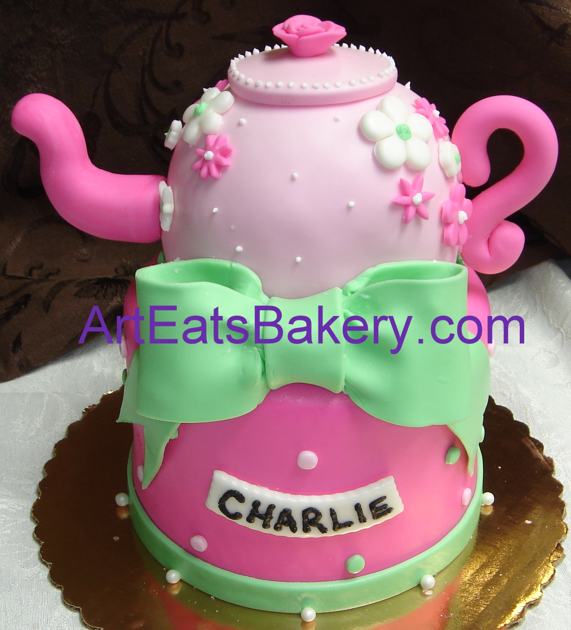 Custom designed girls teapot two tier pink and green fondant birthday cake picture.jpg