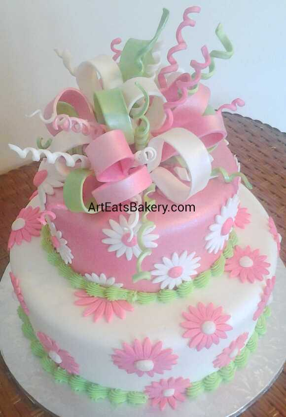Girl's pink, white and green daisy flowers and edible ribbons and bows unique fondant birthday cake design.jpg