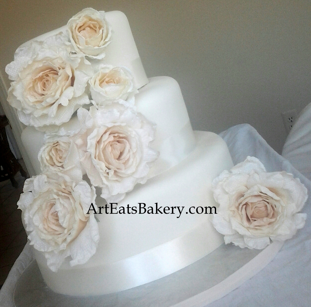 Three tier fondant modern unique wedding cake design with silk roses and ribbons.jpg