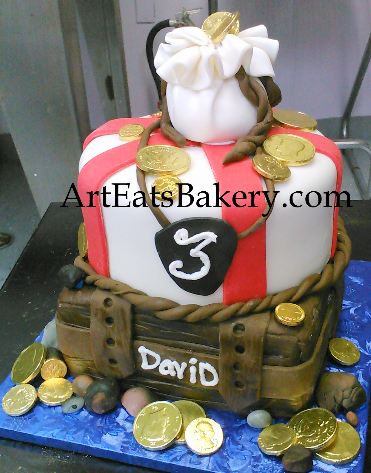 Boy's Pirate treasure chest creative birthday cake with edible money bag and chocolate gold coins.jpg