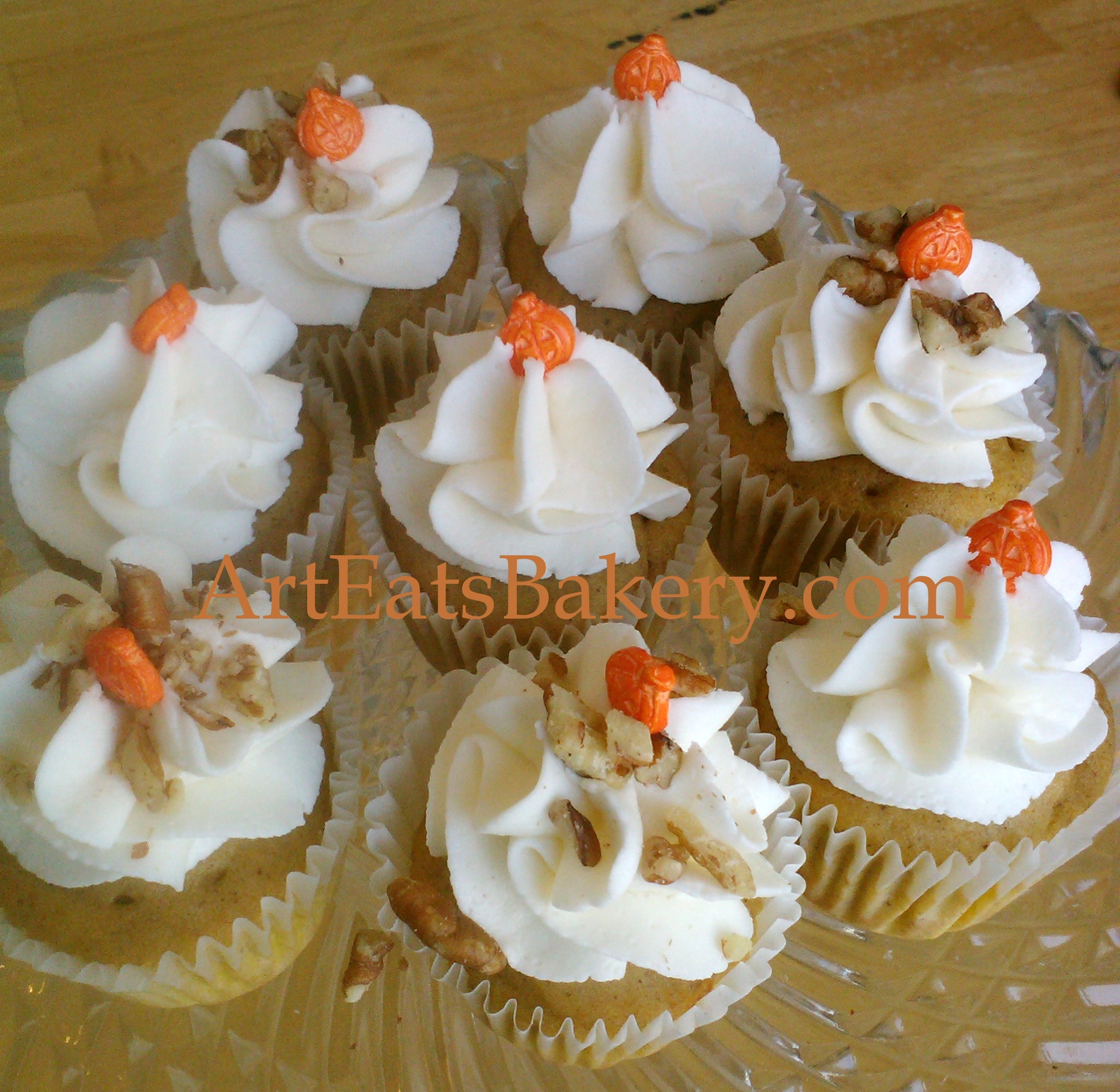 Pumpkin spice cupcakes with cream cheese icing and pecans.jpg